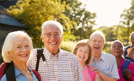 seniors walking on outdoor trail