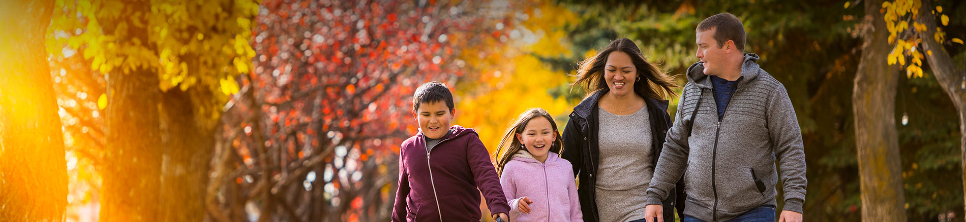 Family walking in the fall time
