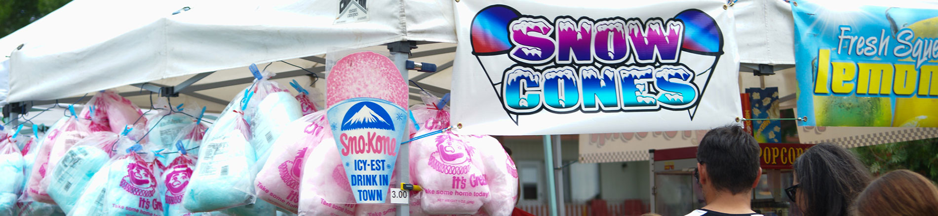 Cotton Candy and Snow Cones at a food tent
