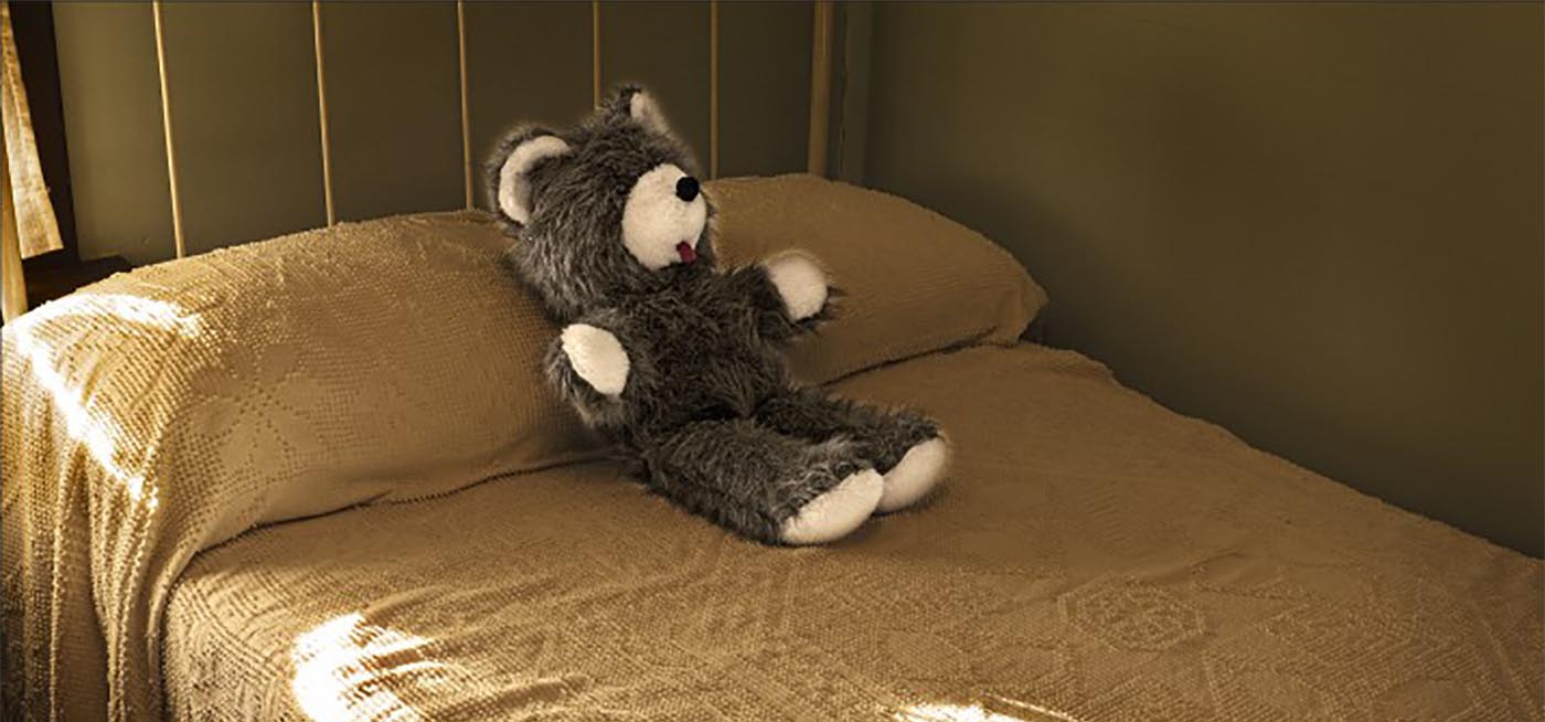Teddy bear on a bed at the Historic Village