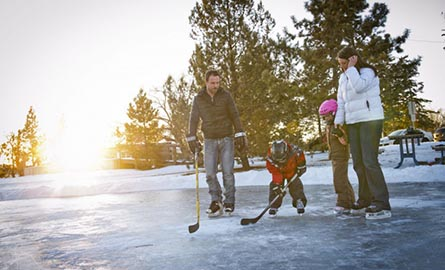 Family skating on an outdoor rink