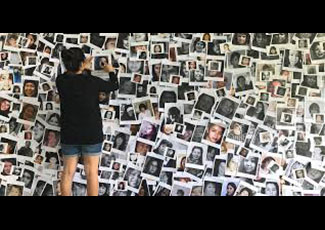 Woman putting pictures on a wall